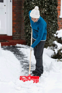 snow shoveling bill -- photo of person shoveling snow from walkway of a home