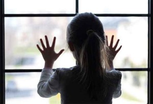 Child custody -- photo of girl with her back to camera staring out window