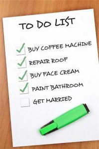 "Photo of ""To Do"" list written in black ink on white paper with green marker"