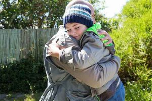 photo of child and parent hugging representing successful co-parenting efforts